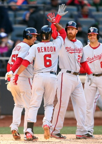 Teammates celebrate Anthony Rendon's home run.